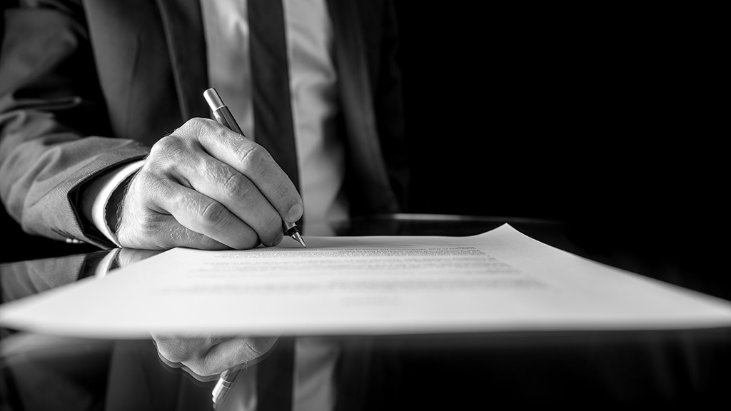 Business lawyers signing papers in Bundoora